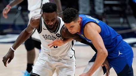 Nets forward Jeff Green, left, and Denver Nuggets