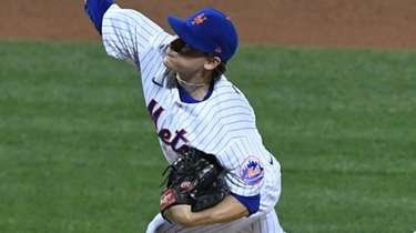 Mets relief pitcher Drew Smith delivers during the