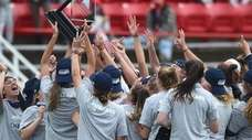 Stony Brook women's lacrosse teammates celebrate after their