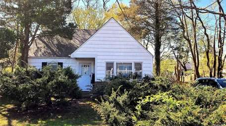 Priced at $300,000, this three-bedroom, two-bathroom expanded Cape