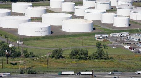 Traffic on I-95 passes oil storage tanks owned