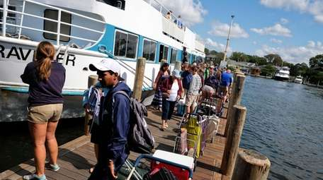 People disembark from a Fire Island ferry in