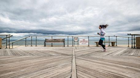 Marisa Reisinger of Queens goes for a run