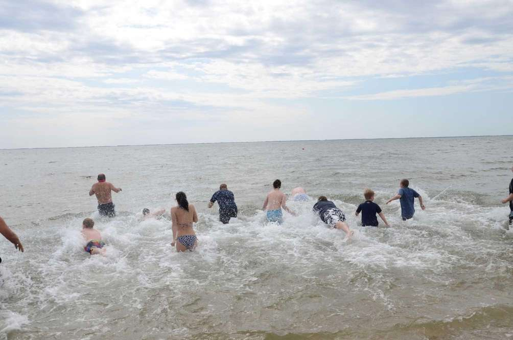 About 100 people plunged into the Great South