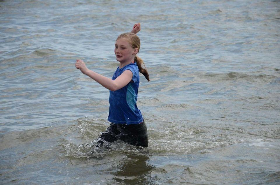 Olivia Boucher, 11, of Sayville, runs out of