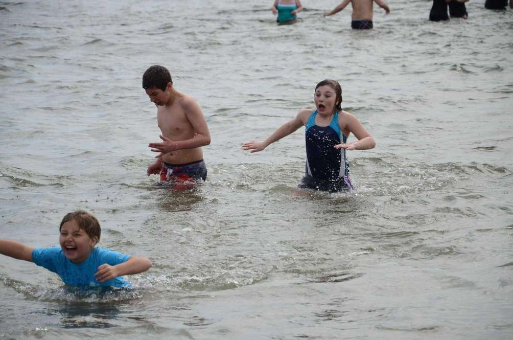 Allison Boucher, 9, comes up for air after