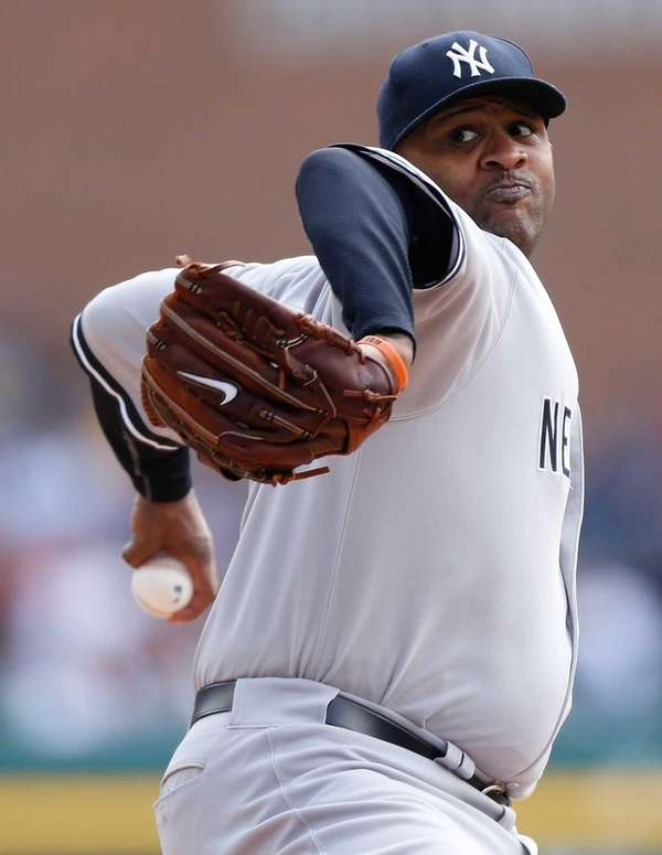 CC Sabathia delivers a first-inning pitch during a