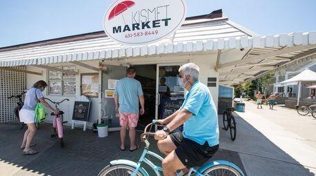 On Fire Island, a biker passes Kismet Market.