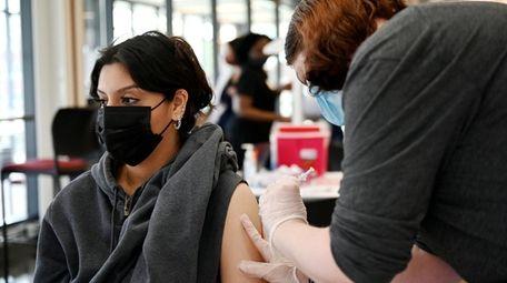 Molloy College nursing student Cassidy Hansen, 20, vaccinates