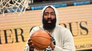 Brooklyn Nets guard James Harden shoots around before