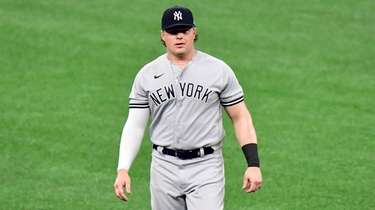 Luke Voit #59 of the Yankees walks on