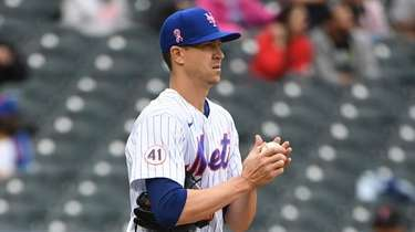 Mets starting pitcher Jacob deGrom reacts during the