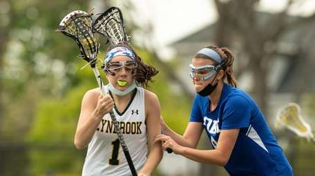 Jillian Swanson of Lynbrook charges down field during