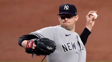 Jordan Montgomery #47 of the Yankees throws a