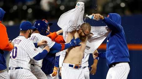 Patrick Mazeika #76 of the Mets is mobbed