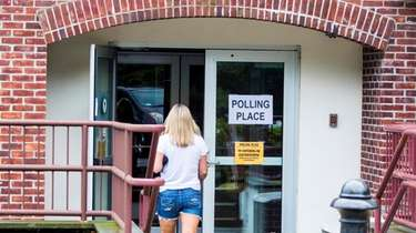 A woman arrives to cast her vote for
