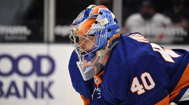 Islanders goaltender Semyon Varlamov protects the net against