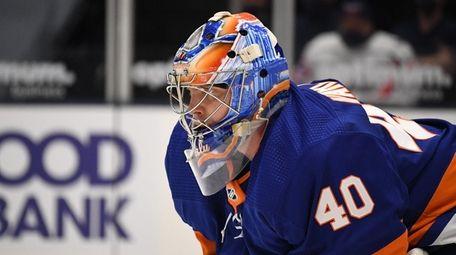 Islanders goaltender Semyon Varlamov protects the net against