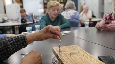 Playing cribbage at a senior center in Billerica,