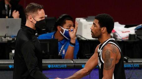 Head coach Steve Nash and Kyrie Irving #11