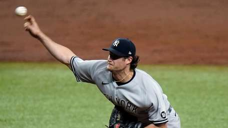 Yankees starting pitcher Gerrit Cole delivers to the