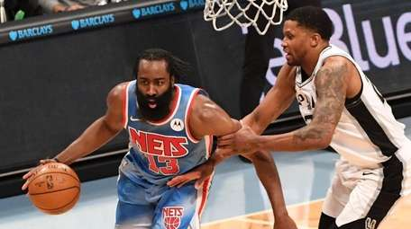 Nets guard James Harden drives the ball past