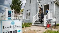 Bidding wars and crowded open houses are still