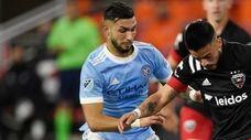 Junior Moreno of D.C. United dribbles the ball