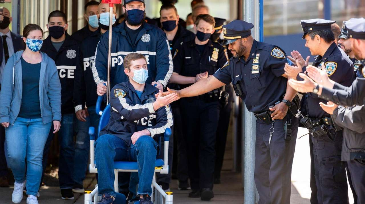 NYPD officer Brian McGurran on Thursday was wheeled