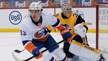 The Islanders' Mathew Barzal skates away from Penguins