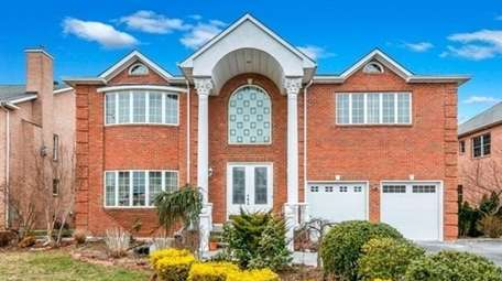 Priced at $1,125,000, this six-bedroom, six-bathroom brick Colonial