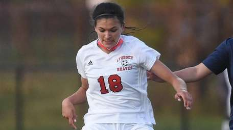 Avani Brandt of Syosset moves the ball under