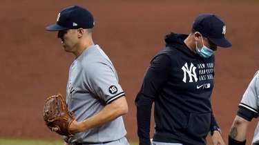 Yankees starting pitcher Jameson Taillon, left, is taken