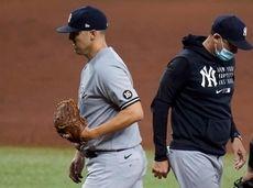 Yankees starting pitcher Jameson Taillon, left, is taken