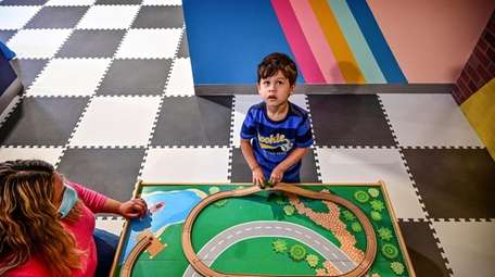 Logan Chavarria, 3, plays at the Kiddie Clubhouse