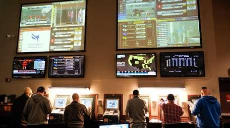 Patrons bet on horse races at The Racing