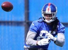 Kelvin Benjamin of the Giants runs drills during