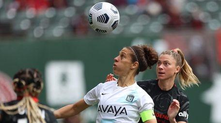 Gotham FC's Carli Lloyd battles for the ball