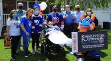 Islanders co-owner Jon Ledecky, third from right, visits