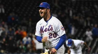 Mets first baseman Pete Alonso reacts after tagging