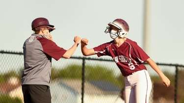Bayshore head coach, Jackie Pasquerella, fist bumps Tiffany