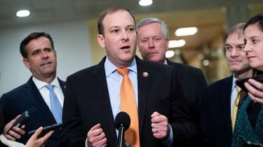 Rep. Lee Zeldin, center, conducts a news conference