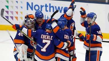 The New York Islanders celebrate after shoot out