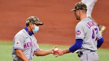 Manager Luis Rojas #19 of the Mets relieves