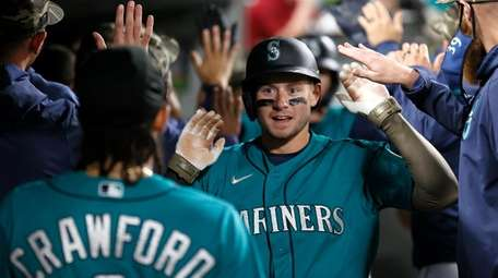 Jarred Kelenic #10 of the Seattle Mariners reacts