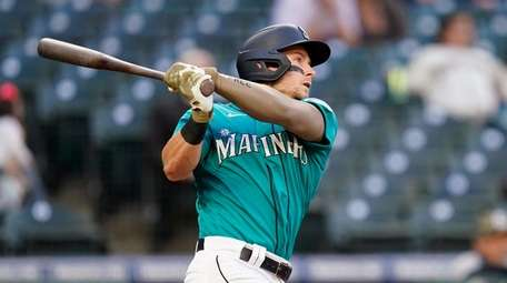 Seattle Mariners' Jarred Kelenic watches his two-run home