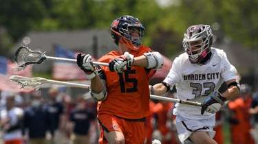 Joey Terenzi of Manhasset shoots and scores during