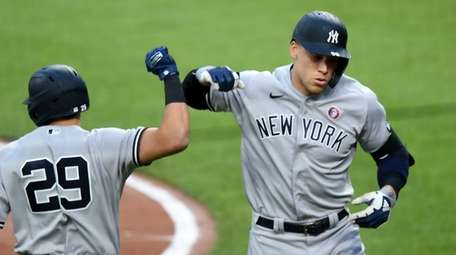Aaron Judge #99 of the Yankees celebrates with