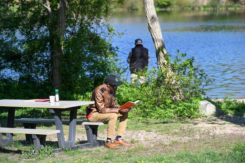 Howard Reynolds, 21, of Middle Island, reads a