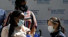 A Queens teen receives her first COVID-19 vaccine
